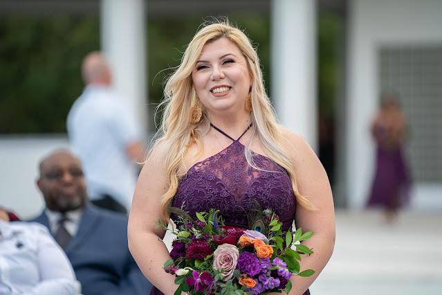 Bridesmaid walking into Wedding Ceremony outside the Mansion at Tuckahoe Jensen Beach FL Wedding Venue
