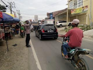 Patroli Dialogis Polsek Anggeraja Polres Enrekang Dengan Pedagang Takjil Himbau Kamtibmas