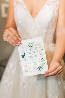 bride holding wedding invitation