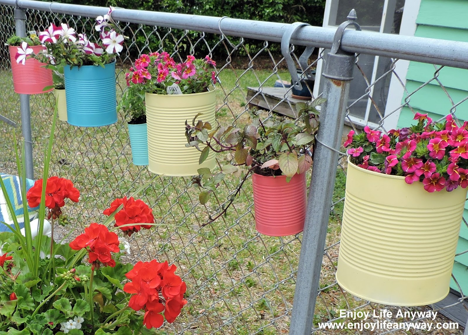 Enjoy Life Anyway Dress Up A Fence With Diy Tin Can Planters