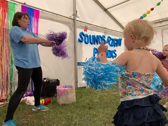 Shaking pompoms at the 3 foot people festival in Chelmsford Sounds Right Phonics class
