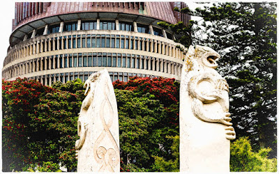 Maori plinth statues in front of the Beehive, Wellington, New Zealand.