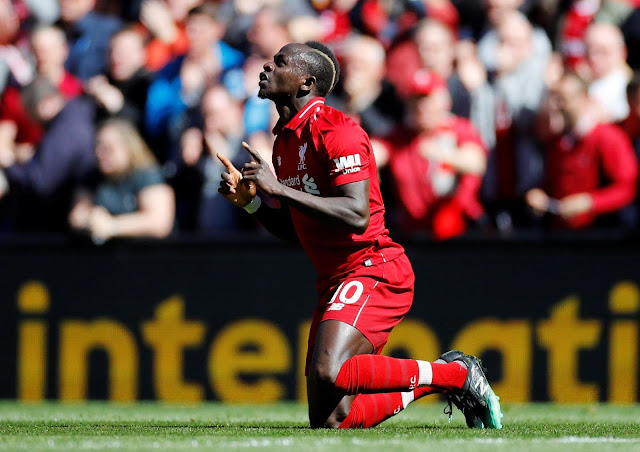Saido Mane celebrates a goal for Liverpool