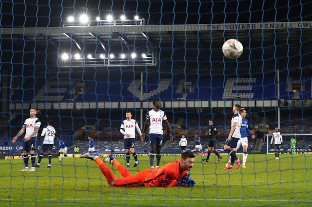 Tottenham goal keeper hugo Lloris watches the ball go into the net against Everton in the FA Cup