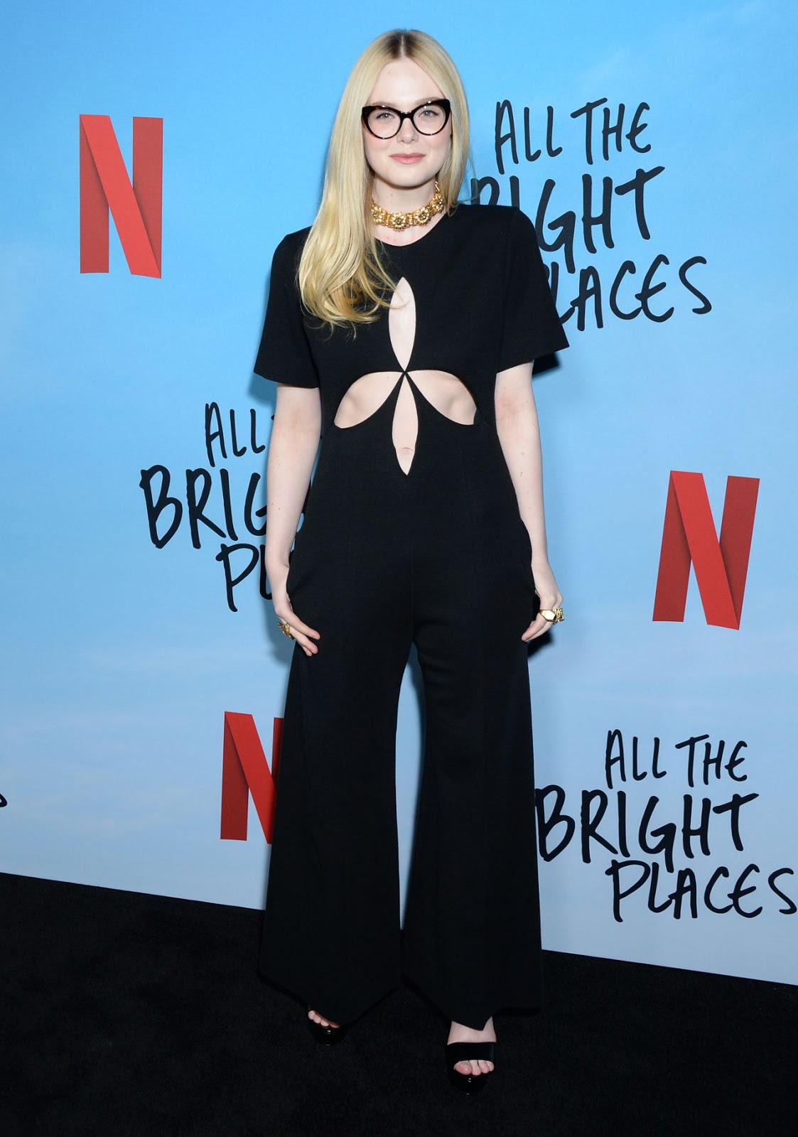 Elle Fanning flashes hints of skin while gracing the red carpet of the All The Bright Places premiere
