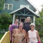 4 older women outside a house