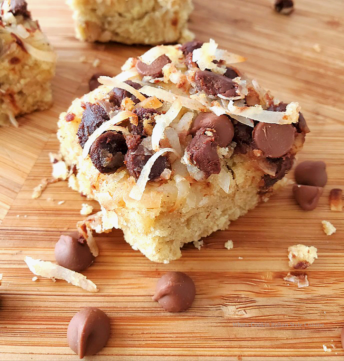 these are a 7 layer magic cookie bar with coconut, chocolate chips and pecans