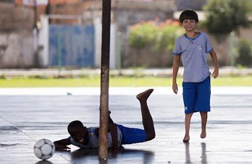 Gabriel Muniz plays football with schoolmates in Campos dos Goytacazes, near Rio de Janeiro