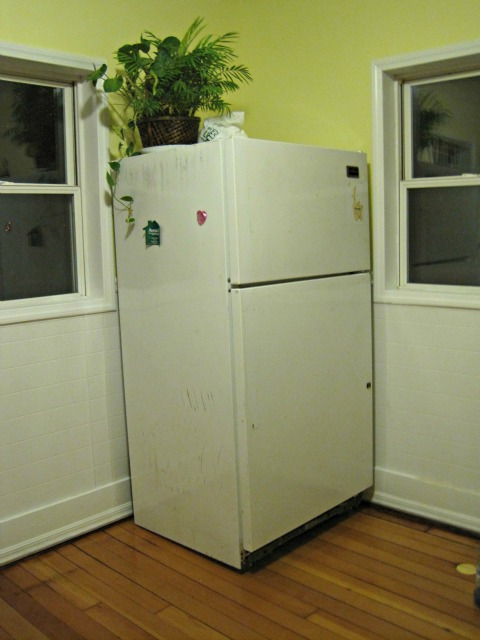 hardwood floor kitchen yellow fridge