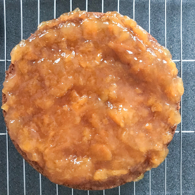 Jam conserve spread onto the cake