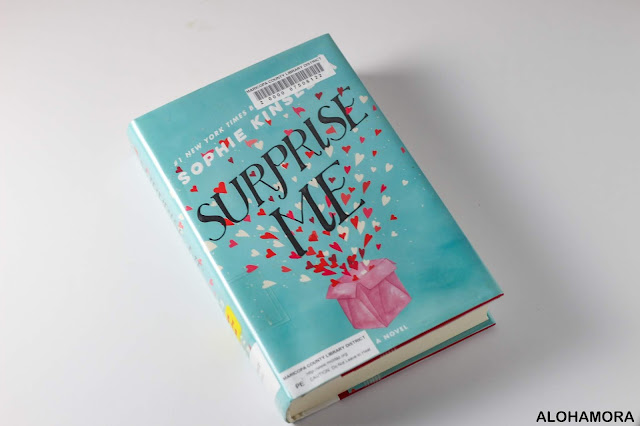 """Surprise Me by Sophie Kinsella adult fiction contemporary lit fun easy read. England, exaggerated, if you like Moriarty's books like """"Big Little Lies"""" check this one out.  Alohamora Open a Book Alohamoraopenabook http://alohamoraopenabook.blogspot.com"""