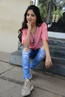 Actress Poonam Kaur Stills in Ripped Jeans at Attack Movie Audio Launch  0051