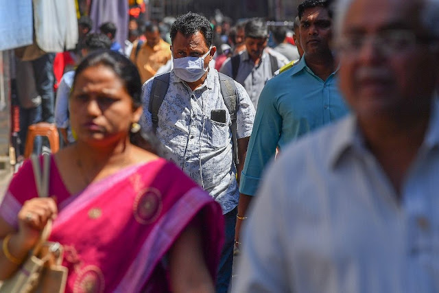 wearing a facemask amid concerns over the spread of the COVID-19 coronavirus
