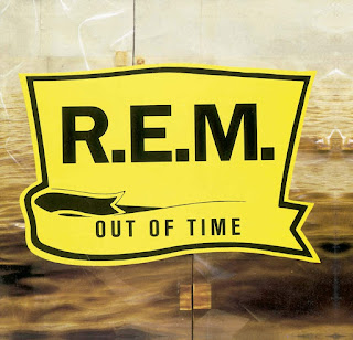 REM Out of Time written in black on a yellow waving-banner shaped outline.