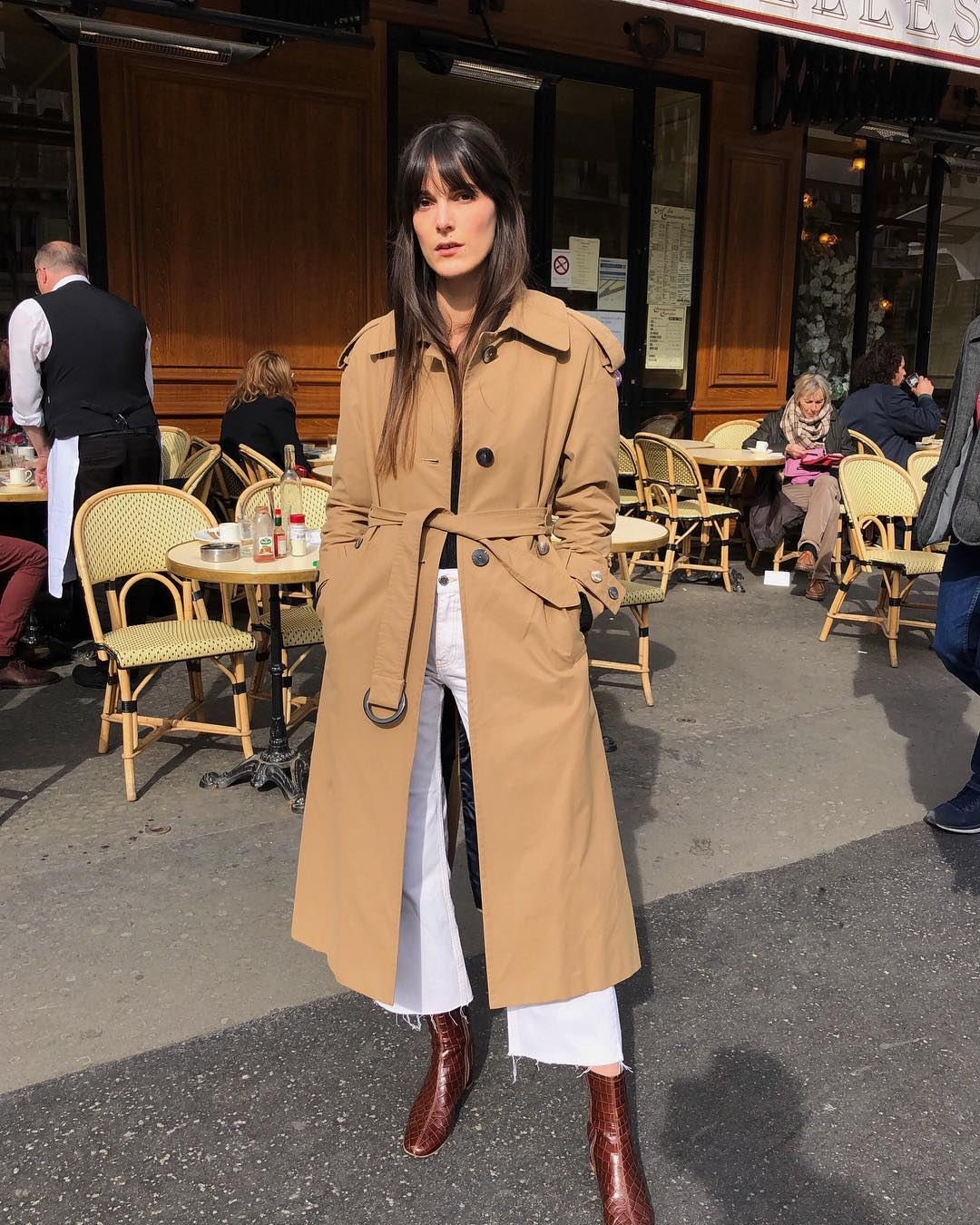 French-Girl Spring Outfit Idea —Leia Sfez in a trench coat, cropped white jeans, and ankle boots