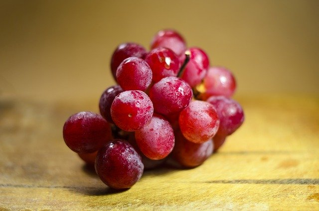 a bunch of frozen red grapes