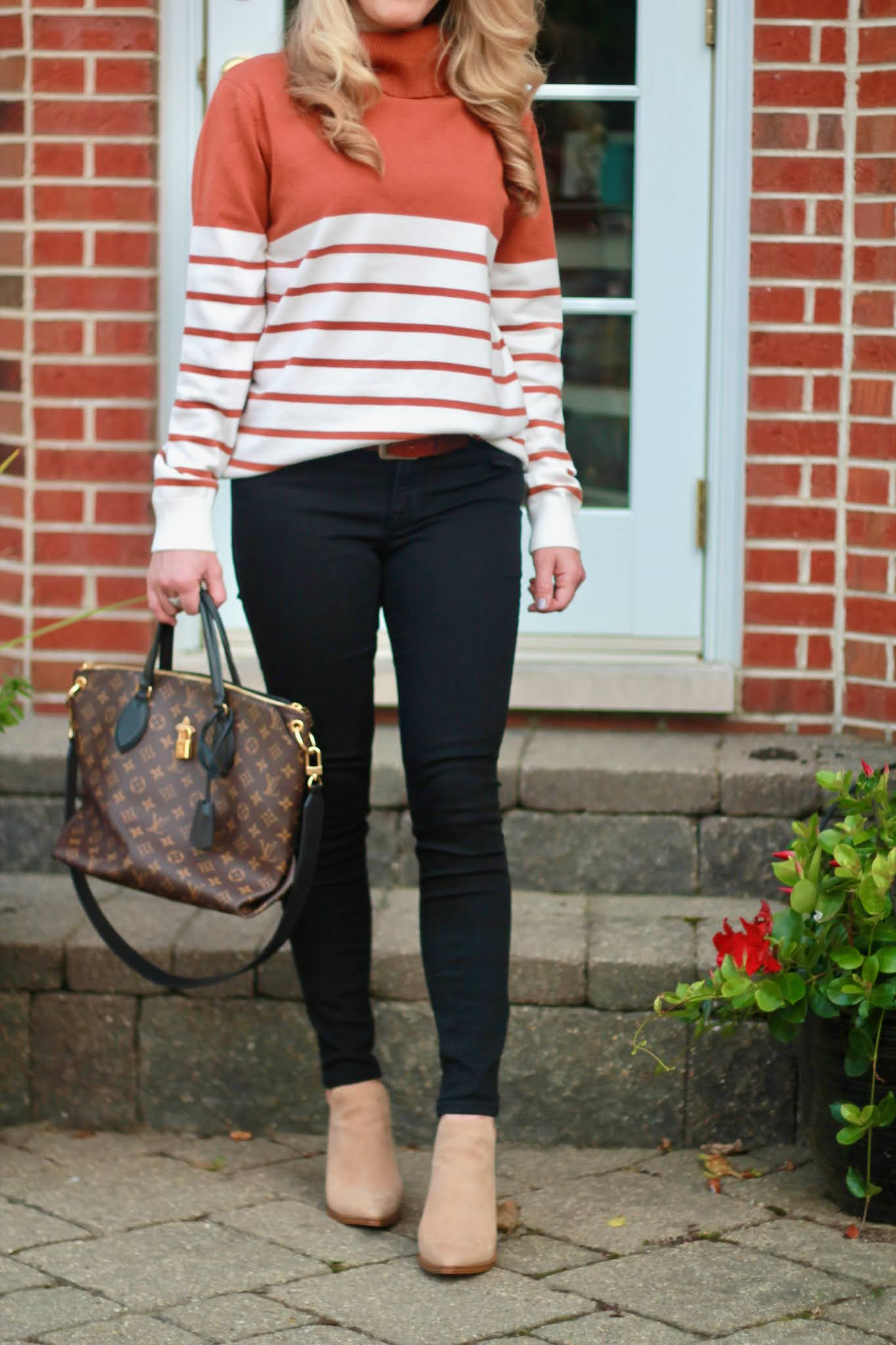 striped rust turtleneck sweater, camel brown fedora, black skinny jeans, taupe booties, casual winter outfit
