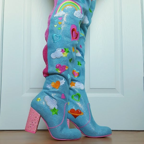wearing Irregular Choice thigh high boots in blue