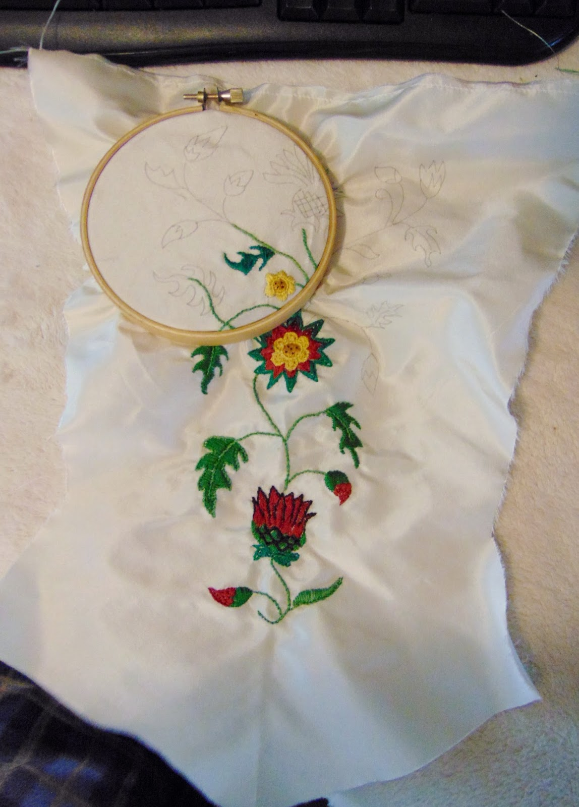 The antique sewist pet en lair silk taffeta with embroidered below luckily i was using a rather small embroidery hoop and had no trouble fitting the design without the hoop going over the edges of the fabric ccuart Choice Image