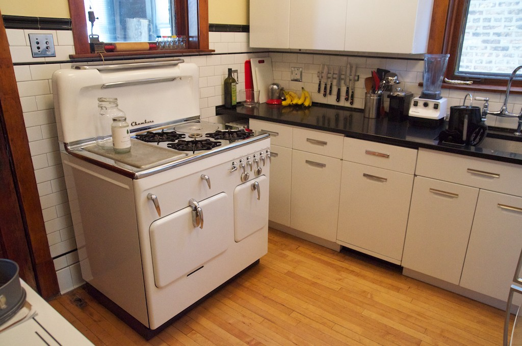 White Chambers stove Model C highback in retro kitchen with steel cabinets,  Chicago, Illinois
