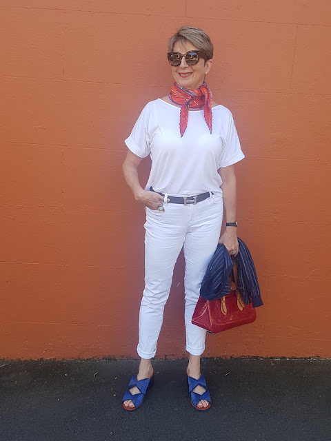 White outfit with bright accessories