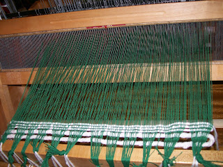Waste weft stabilizes warp for weaving.