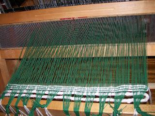 Waste weft stabilizes warp for weaving.