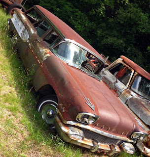 Old station wagon, in poor condition.