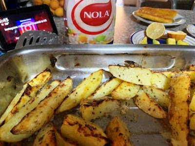 Baked potatoes with NOLA Mayonnaise sauce, and fish in background