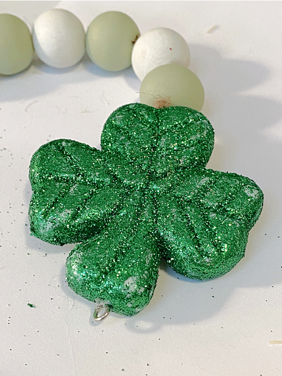 Green glittered shamrock on end of jute