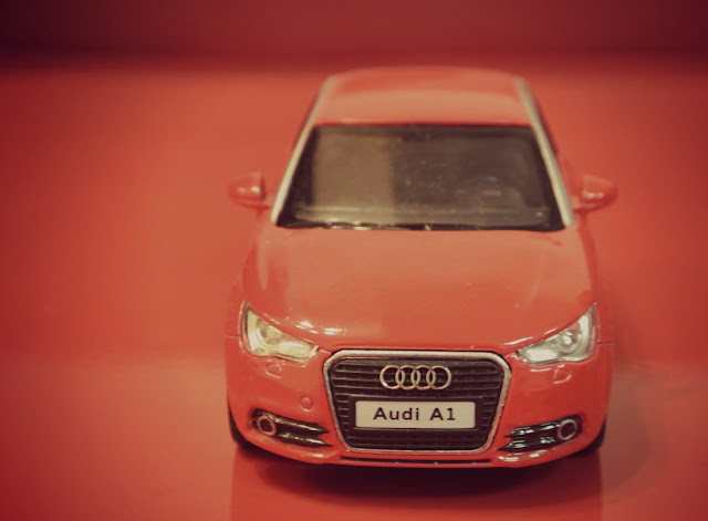 red audi toy car hatchback