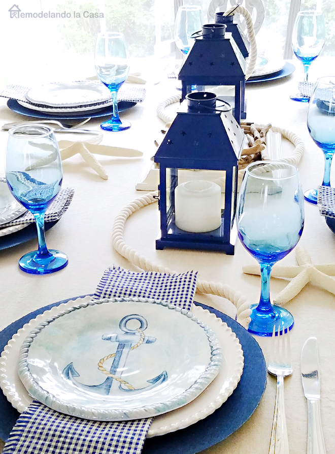 blue and white table with gingham napkins and anchor salad plates