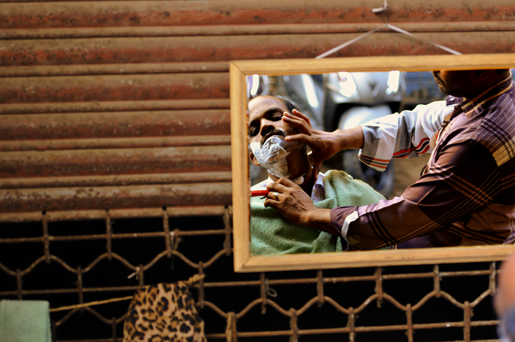 Barbershop in Chor Bazaar in Mumbai, India submitted to the weekly challenge 'On the Otherside of the Mirror' on Better Photography.