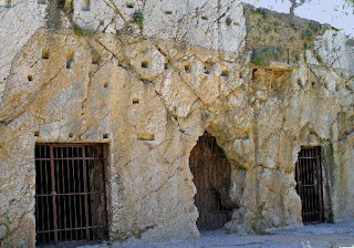 This is a very interesting picture of an ancient prison in Athens, Greece. Although most likely not the prison that Socrates died in, nevertheless a good example of what it may have looked like with its stone front and metal bars.