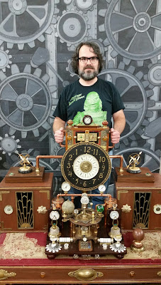 Man steering a 19th Century-style time machine.