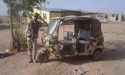 Nigerian solider poses with Army-themed keke Napep at Boko Haram war front