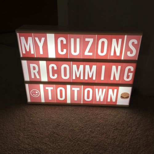 light box showing text my cuzons r comming to town