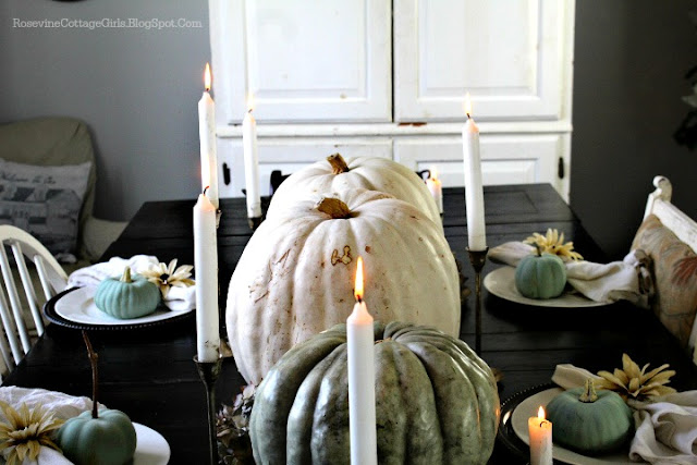 Green and white large pumpkins down the center of the table with candles for thanksgiving decor | rosevinecottagegirls.com | Farmhouse Thanksgiving Tablescape