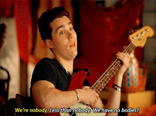 Jeremy Shada sitting with a bass guitar, and captions that say: We're nobody. Less than nobody. We have no bodies.