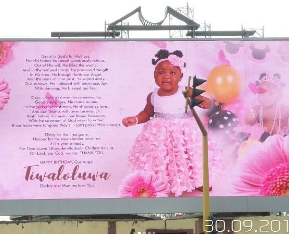 Lucky girl! Comedian Seyilaw gets a billboard in Lagos to celebrate daughter