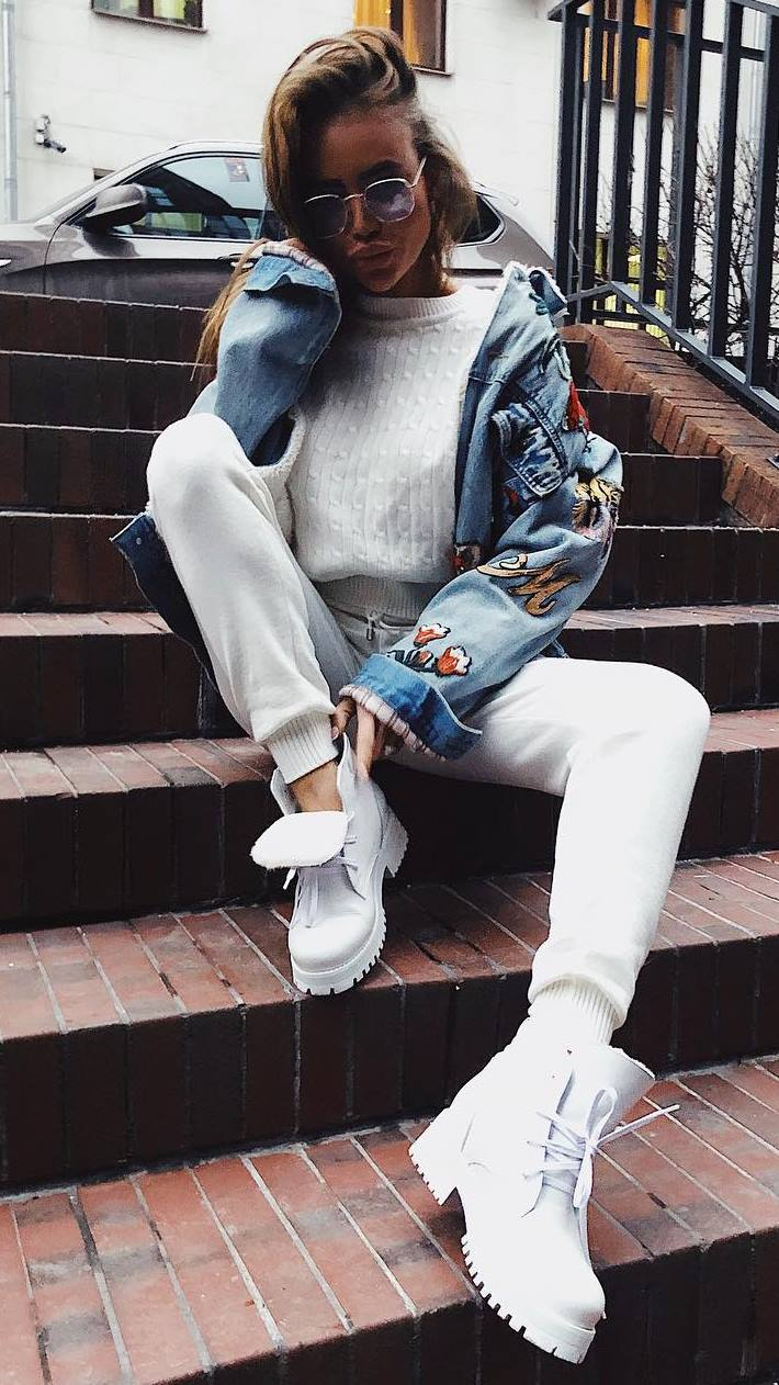 what to wear this fall : embroidered denim jacket + white sweater + boots + pants