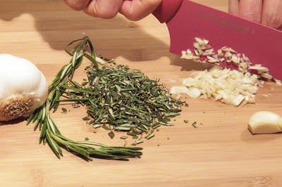 rosemary and garlic on cutting board