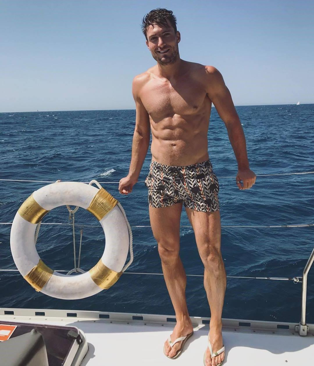 boat-party-sea-shirtless-handsome-dude-smiling-strong-male-legs-muscle-thighs