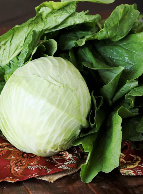 Head of Cabbage and Bunch of Collard Greens Image
