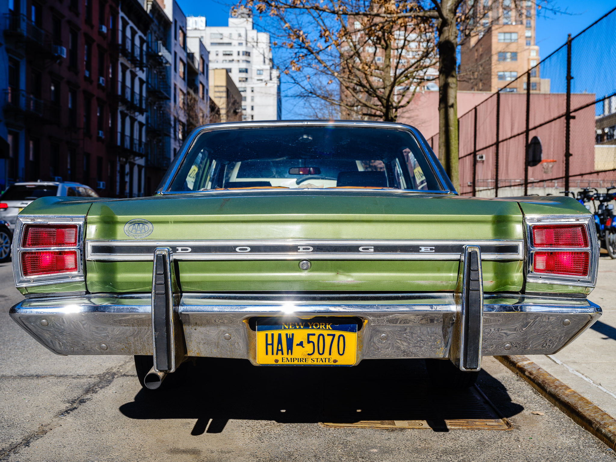 a photo of a classic green dodge dart in new york city