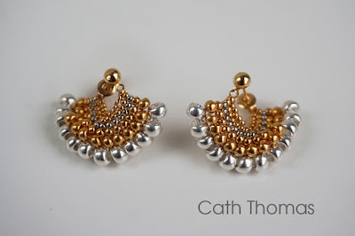 https://caththomasdesigns.indiemade.com/product/fandango-earrings-ear-huggers