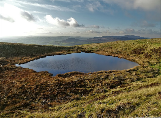 A view over the Mermaid's Pool, with the High Peaks in the distance