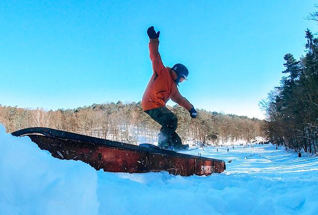 tailpress na snowboardzie