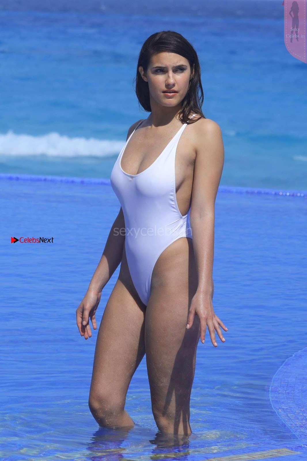 Tao Wickrath in sexy white Revealing One Piece Swimsuit in Miami 03.08.2017