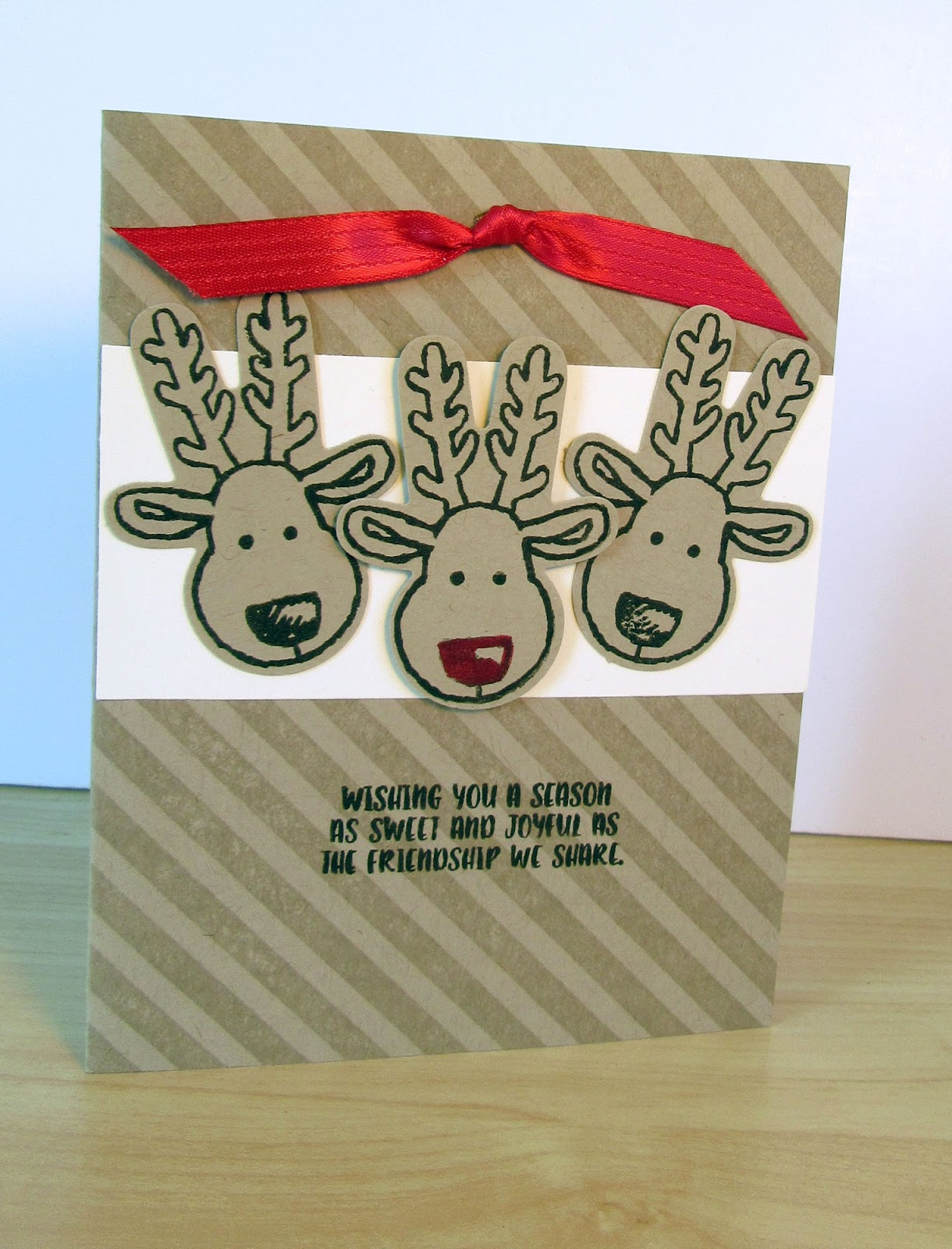Christmas card by Joyce Hall featuring the Reindeer from Stampin'UP's Cookie Cutter stamps and Cookie Cutter Punch